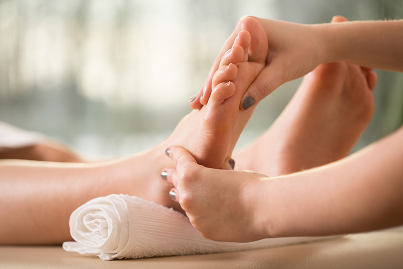 Woman's foot receiving Zone Therapy