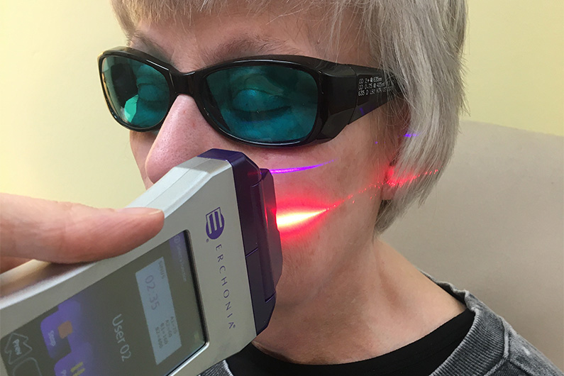 Woman receiving Cold Laser treatment